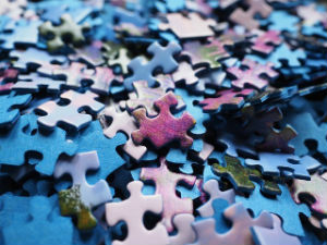 Empty Pursuits Made Eternally Meaningful - Weekly Blog Post by Dr. Craig Biehl - blue and purple puzzle pieces in stack