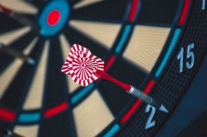 Missing the Mark - Weekly Blog Post by Dr. Craig Biehl - colorful dart board with dart at edge